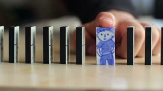 Businessman stop domino effect. Risk management and life insurance concept