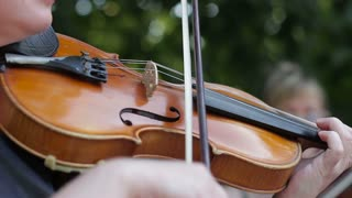 Close-up of playing the violin on the street, Earning money