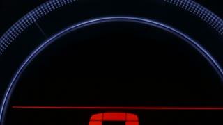 Closeup of a blinking hazard dashboard lights on a car.
