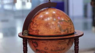 Decorative globe with an old world map