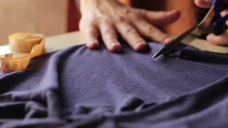 Dressmaker cutting fabric, close-up