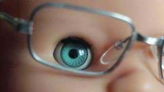 Eye doll looking at camera