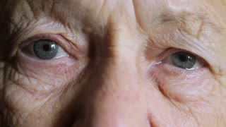 Eyes of an old woman crying