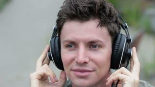 Guy enjoying music on headphones, close-up