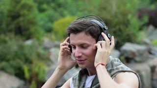 Guy enjoys music on headphones