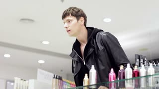 Handsome guy in the perfume shop