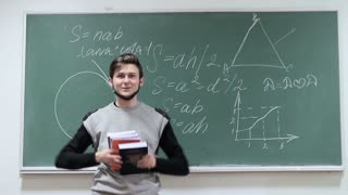 happy student on a blackboard background jumping with happiness