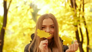 Happy young girl in the autumn park.