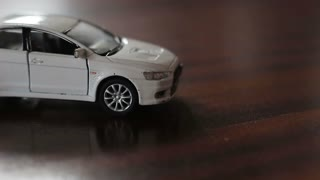 Head-on collision of two toy cars. Accident of a white and gray car