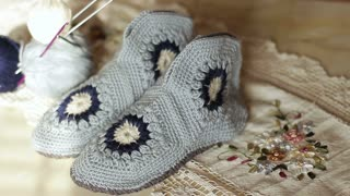 Knitted handmade shoes. Close up