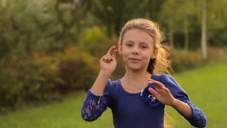 little girl showing a hand a peace symbol