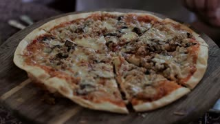 male hands taking slices of pizza. Close-up