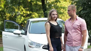 New Car: Young couple win or buy a new modern car and joy