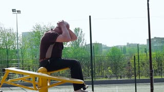 Old man doing exercise on bars outdoor. Street workout