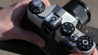 Photographer Pressing Shutter Button in Retro Phot. Close-up