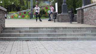 Rides roller skates. Close-up