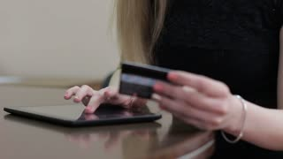 Shopping online with credit card on digital tablet. Close-up