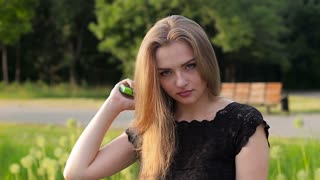 Silky and well-groomed hair young blonde girl. Combing