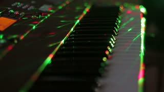 Synthesizer against the background of night club lights
