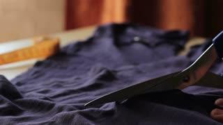 Tailor. Man Hands notch tailor tailor's scissors cloth. Close Up
