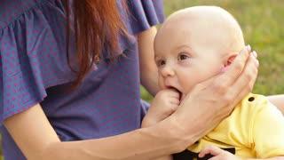 Teething baby biting fingers