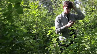 The man was lost in the forest. He found a way out with gps-navigator