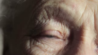 The old woman's eye close up