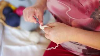 Woman hands close up knitting. Close up
