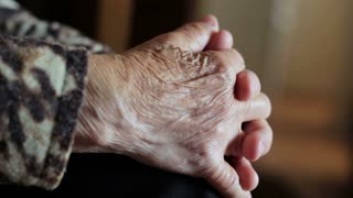 wrinkled hands of an old woman. concept of old age and longevity