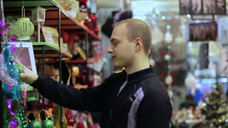 Young buyer selects items in the gift store