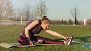 Young girl doing exercises for body flexibility