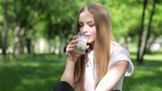Young Girl drinking milk and shows thumb up