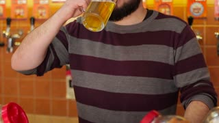 Young Owner tasting beer in a pub. Small business