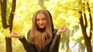Young woman enjoys autumn. close-up