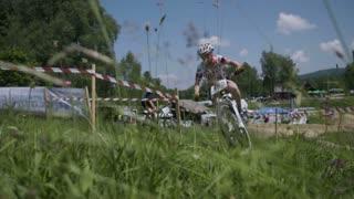Bikers riding uphill.