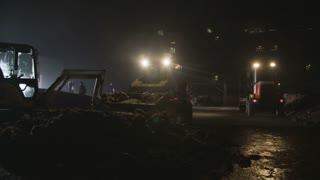 Bulldozer Bobcat Moving A Pile Of Dirt
