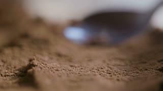 Coffee Spoon Sliding Over A Fresh Ground Coffee