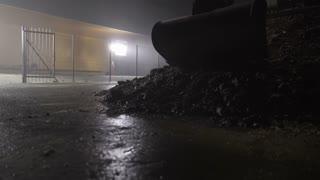 Hydraulic Excavator Using Bucket Arm