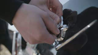 Man Is Opening A Car Trunk With A Key