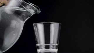 Pouring water in to glass.