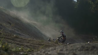 Two riders on motocross trail.