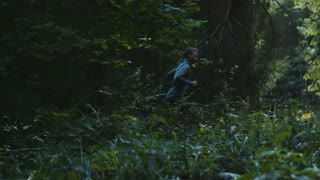 Young Man Running Jogging In Forest
