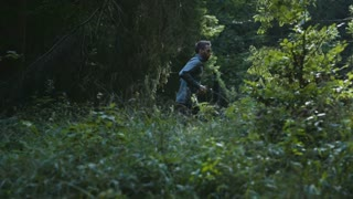 Young Man Running Jogging Through A Forest 1