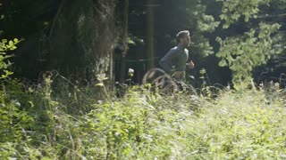Young Man Running Jogging Through A Forest 2