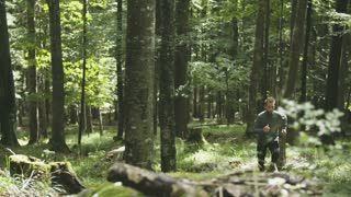 Young Man Running Jogging Through A Forest 3