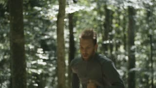 Young Man Running Jogging Through A Forest 4