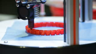 A 3d printing head/nozzle precisely lays down its next layer
