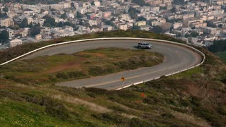 A car climbs up the long twisting road to the Twin Peaks, San Francisco