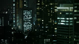 A moody fluorescent colored view of the Tokyo cityscape at Night