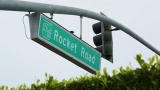 """A Road Sign marks """"Rocket Road,"""" near Space X Headquarters"""